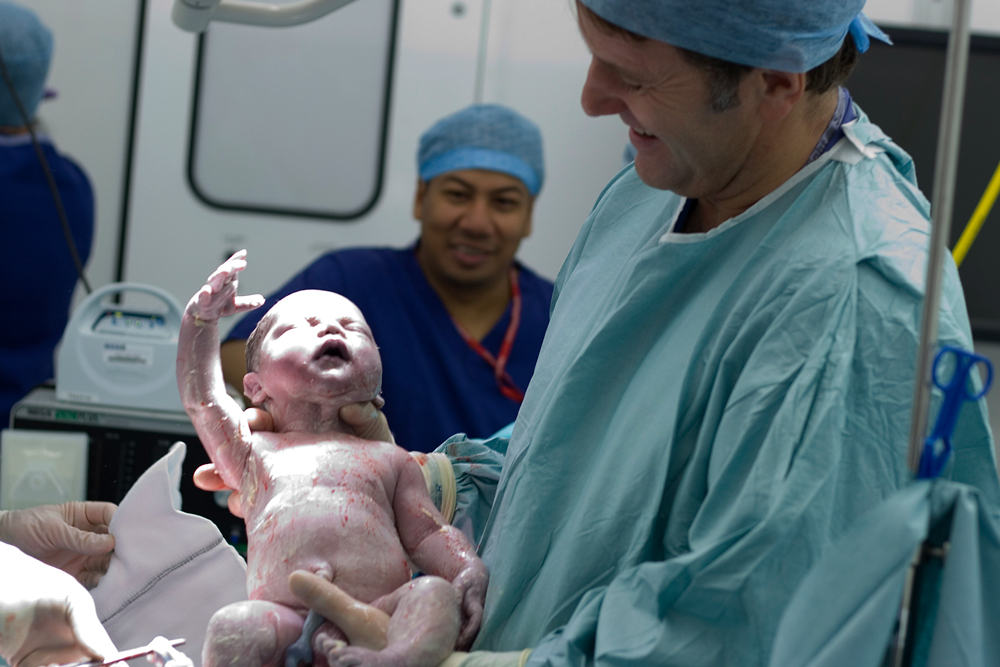 Dr Chris Barnick delivering a baby